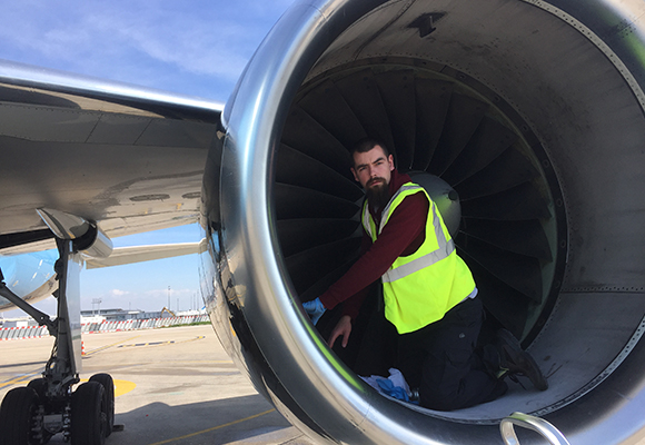 Testia Inspector conducting penetrant testing in an aircraft engine at Orly Airport