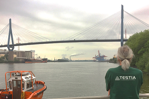Testia team member in front of the Köhlbrand bridge in Hamburg, Germany